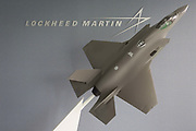 The Lockheed Martin logo and a model of their F-35 Lightening fighter in the companys hospitality chalet at the Farnborough Airshow, on 18th July 2018, in Farnborough, England.