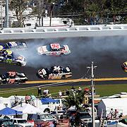 NASCAR Sprint Cup Series drivers Michael Waltrip (15) and David Reutimann (00) are involved in a multi car crash during the Daytona 500 at Daytona International Speedway on February 20, 2011 in Daytona Beach, Florida. (AP Photo/Alex Menendez)