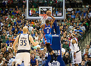 /Russell Westbrook (0) of the Oklahoma City Thunder dunks the ball against the Dallas Mavericks at the American Airlines Center in Dallas on Sunday, March 17, 2013. (Cooper Neill/The Dallas Morning News)