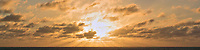 Panorama of the Morning Sun and Clouds over the Atlantic Ocean. Composite of 17 images taken with a Nikon 1 V3 camera and 70-300 mm VR lens