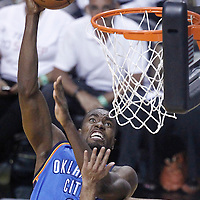 21 June 2012: Oklahoma City Thunder power forward Serge Ibaka (9) goes for the dunk during the Miami Heat 121-106 victory over the Oklahoma City Thunder, in Game 5 of the 2012 NBA Finals, at the AmericanAirlinesArena, Miami, Florida, USA. The Miami Heat wins the series 4-1.