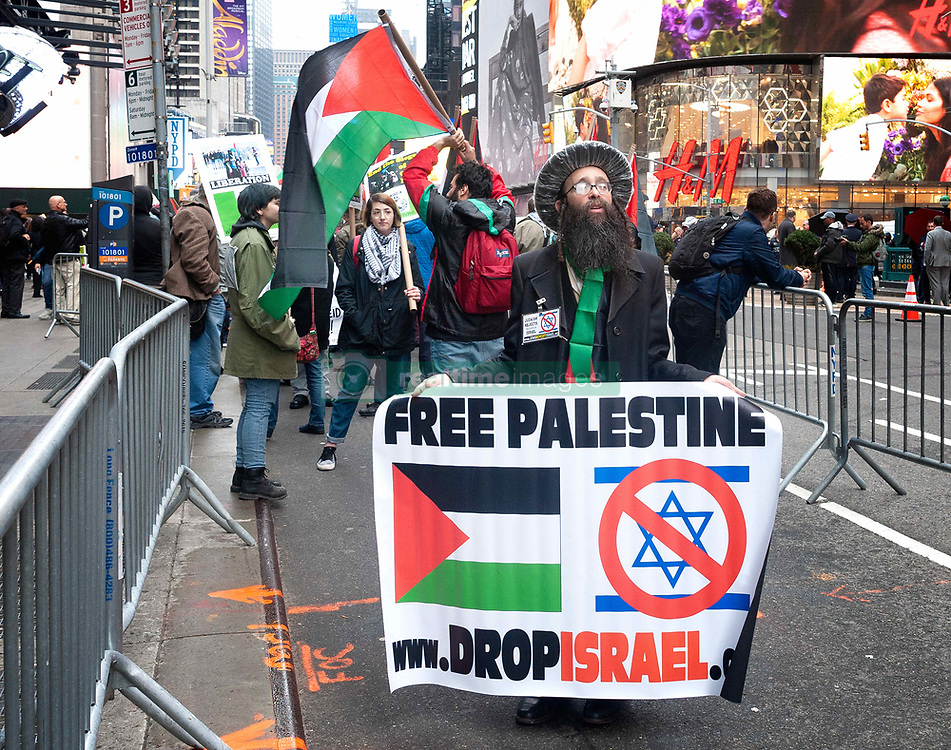 March 30, 2019 - New York, New York, United States - Activists gathered in Times Square in New York City to commemorate the first year anniversary of the ''Great March of Return' (Credit Image: © Gabriele Holtermann Gorden/Pacific Press via ZUMA Wire)