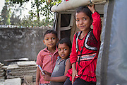 Children pose in a small village in India. Portrait photography by Debbie Zimelman, Modiin, Israel