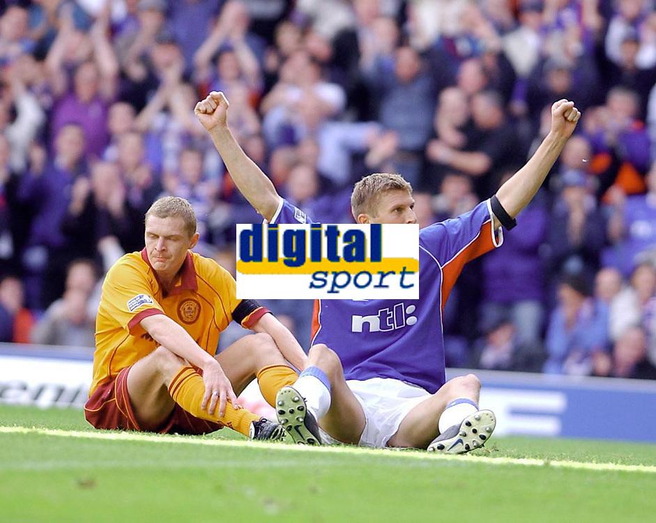 Fotball: Rangers v Motherwell 3-0, Scottish Premier League<br /><br />Flo celebrates as Corrigan looks disgusted aftyer Ranger's opening goal