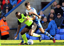 Peterborough United's Joe Newell in action with Oldham Athletic's Genserix Kusunga - Photo mandatory by-line: Joe Dent/JMP - Mobile: 07966 386802 - 04/10/2014 - SPORT - Football - Peterborough - London Road Stadium - Peterborough United v Oldham Athletic - Sky Bet League One