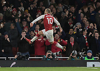 Football - 2017 / 2018 Premier League - Arsenal vs. Chelsea<br /> <br /> Jack Wilshere (Arsenal FC) leaps into the air after scoring the opening goal of the game at The Emirates.<br /> <br /> COLORSPORT/DANIEL BEARHAM