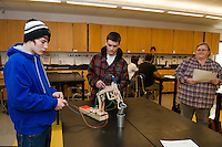 """Laconia High School students Seth Noe and River Richer maneuver their """"Robot Arm"""" Monday morning during their CCR Applied Physics class with Joanne Gilbert.  (Karen Bobotas/for the Laconia Daily Sun)"""