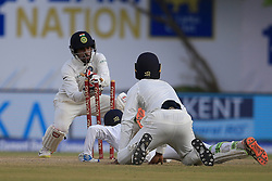 July 27, 2017 - Galle, Sri Lanka - Sri Lankan cricketer Upul Tharanga is run out despite his dive  as Indian Wicket keeper Wriddhiman Saha (2L) removes the bails during the 2nd Day's play in the 1st Test match between Sri Lanka and India at the Galle International cricket stadium, Galle, Sri Lanka on Thursday 27 July 2017. (Credit Image: © Tharaka Basnayaka/NurPhoto via ZUMA Press)