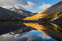 Reflections of the fall colors and Red Mountain in Crystal lake along the Million Dollar Highway.  San Juan Mountains, Colorado.