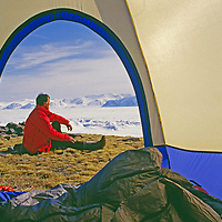 NUNAVUT, CANADA. Tourist camp in sedge meadow on Bylot Island, beside frozen Eclipse Sound and north of Baffin Island (bkg.)