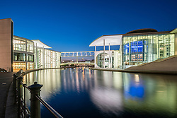 Night view of  Paul Lobe Haus and Marie Elisabeth Luders ( Lueders) Haus government buildings beside River Spree in Berlin Germany