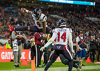 American Football - 2019 NFL Season (NFL International Series, London Games) - Houston Texans vs. Jacksonville Jaguars<br /> <br /> Deshaun Watson, Quarterback,(Houston Texans) leaps over a Jacksonville player only to see his touchdown denied for being out of play at Wembley Stadium.<br /> <br /> COLORSPORT/DANIEL BEARHAM