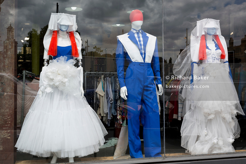 Three shop mannequins dressed in red, white and blue coloured clothing, stand in the window of second-hand clothes retailer Traid, on 4th July 2017, in Brixton, London, England.