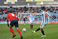 Adam Hammill of Huddersfield Town fires home the equaliser against Blackburn Rovers during the Sky Bet Championship match at the John Smiths Stadium, Huddersfield<br /> Picture by Graham Crowther/Focus Images Ltd +44 7763 140036<br /> 15/03/2014