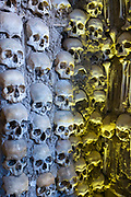 Thousands of human skulls and bones in Chapel of Bones - Capela dos Ossos - in Church of Saint Francis, Evora, Portugal