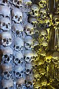 Thousands of human skulls and bones in Chapel of Bones - Capela dos Ossos - in Church of Saint Francis, Evora, Portugal