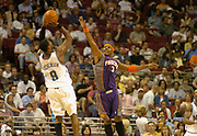 March 26, 2005, Orlando, Florida, USA;  Quentin Richardson of the Phoenix Suns attempts to block the shot of DeShawn Stevenson of the Orlando Magic as the Suns defeat the Magic 118-116.