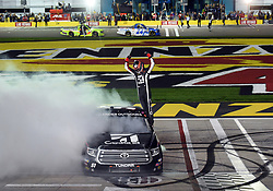 March 1, 2019 - Las Vegas, NV, U.S. - LAS VEGAS, NV - MARCH 01: Kyle Busch (51) KBM Toyota Tundra climbs on to his truck and celebrates the race win during the NASCAR Gander Outdoors Truck Series Strat 200 on March 01, 2019, at Las Vegas Motor Speedway in Las Vegas, NV. (Photo by Chris Williams/Icon Sportswire) (Credit Image: © Chris Williams/Icon SMI via ZUMA Press)