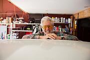 Smiling Senior Man In Garage