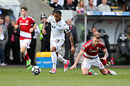Luciano Narsingh of Swansea city breaks away from Adam Clayton of Middlesbrough ®.  Premier league match, Swansea city v Middlesbrough at the Liberty Stadium in Swansea, South Wales on Sunday 2nd April 2017.<br /> pic by Andrew Orchard,