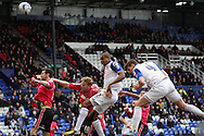 Tranmere Rovers' Stephen Arthurworrey (c) heads over the crossbar. Skybet football league 1match, Tranmere Rovers v Oldham Athletic at Prenton Park in Birkenhead, England on Saturday 1st March 2014.<br /> pic by Chris Stading, Andrew Orchard sports photography.