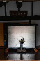 """Goshoji Ikebana- Midway up a small hill facing the Seto Inland Sea is Goshoji Temple, the 78th sacred spot along the Shikoku Henro pilgrimage. It is said that Kobo Daishi paid a visit to Goshoji Temple in 807, where he made a vow to ward off evil, and built a statue there. Even today Goshoji is famous as the temple """"where Kobo Daishi wards off evil"""". During the Kamakura period, Ippen Shonin, the founder of the Jishu sect, visited Goshoji Temple and propagated the Nenbutsu Odori, a type of Buddhist incantation with dance. As a result, Goshoji Temple is the only temple belonging to the Jishu sect on the Shikoku Henro pilgrimage. As the majority of sacred spots on the pilgrimage are associated with the Shingon sect of Buddhism, the fact that Goshoji Temple is a place of worship for both the Shingon sect and the Jishu sect makes it very unique."""