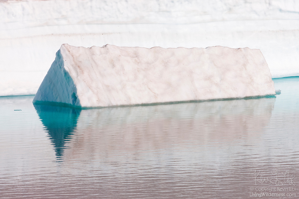 A triangular iceberg floats in Frozen Lake, located in the Sunrise area of Mount Rainier National Park, Washington. While the lake surface thaws in the summer, it's usually surrounded by large packs of snow and ice year-round. The lake serves as the water supply for the Sunrise area of the park.