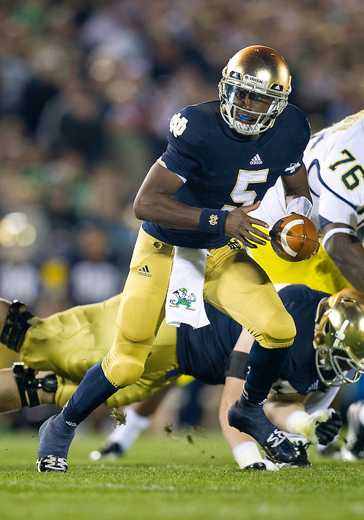 September 22, 2012:  Notre Dame quarterback Everett Golson (5) pivots into the back field during NCAA Football game action between the Notre Dame Fighting Irish and the Michigan Wolverines at Notre Dame Stadium in South Bend, Indiana.  Notre Dame defeated Michigan 13-6.