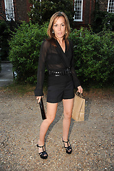 TARA PALMER TOMKINSON leaving a summer party hosted by Lady Annabel Goldsmith at her home Ormeley Lodge, Ham Gate, Richmond on 13th July 2010.