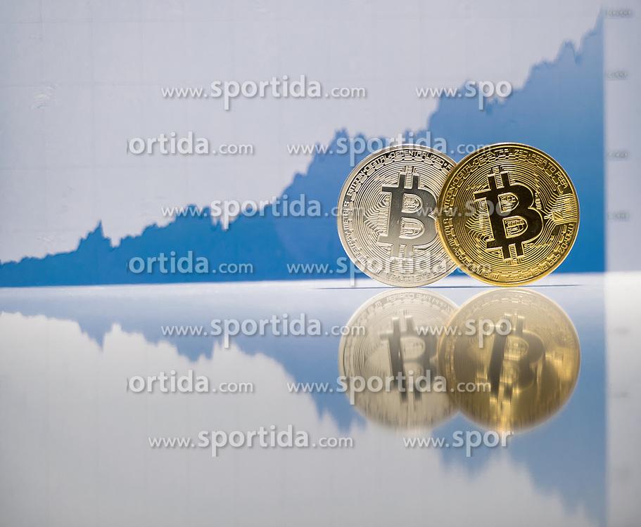 THEMENBILD - Bitcoin knackte heute erstmals die 10.000 Dollar Grenze. Kryptowährung Bitcoin ist ein dezentrales Zahlungsmittel auf Blockchain Basis, das es seit 2008 gibt. Aufgenommen am 29. Novmeber 2017 in Wien, Österreich // Bitcoin soared to an all-time high above $ 10.000 today. Bitcoin is a decantralized worldwide cryptocurrency and digital payment system. Vienna, Austria on 2017/11/29. EXPA Pictures © 2017, PhotoCredit: EXPA/ Michael Gruber