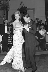 Diana, The Princess of Wales wearing a dress by designer Catherine Walker, a blue and pink rose-patterned silk, dances the night away with husband The Prince of wales in Melbourne, Australia.