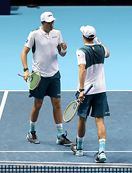 Bob Bryan (left) and Mike Bryan in action during their doubles match during day two of the NITTO ATP World Tour Finals at the O2 Arena, London.