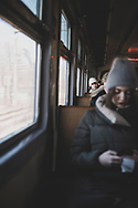 Passengers travel by train between the Latvian cities of Riga and Jurmala. (March 15, 2020)