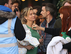 © Licensed to London News Pictures. 12/10/2015. London, UK. Actress Renee Zellwegger has her costume adjusted as she films Bridget Jones Diary in Borough Market. Photo credit: Peter Macdiarmid/LNP