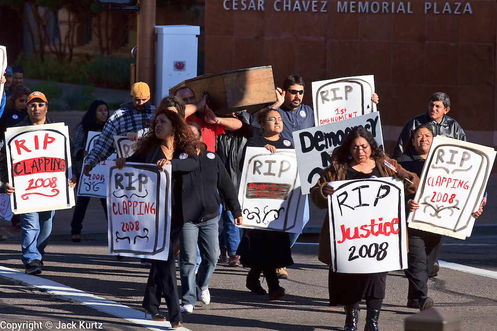 """05 DECEMBER 2009 -- PHOENIX, AZ: The funeral procession for civil rights marches to the Maricopa County Board of Supervisors meeting in Phoenix, AZ, Monday. About 200 people from several Phoenix area civil rights groups held a mock """"funeral"""" for civil rights in Phoenix Monday to protest actions taken by the Maricopa County Board of Supervisors recent decisions that limit protestors' ability to speak out against Sheriff Joe Arpiao during Board of Supervisors meetings. The protestors have been attending meetings to protest the Sheriff's series of anti-immigrant sweeps in Latino neighborhoods of Phoenix. Photo by Jack Kurtz / ZUMA Press"""