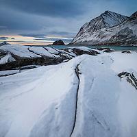 Snow covered winter landscape at Haukland beach, Vestvågøy, Lofoten Islands, Norway