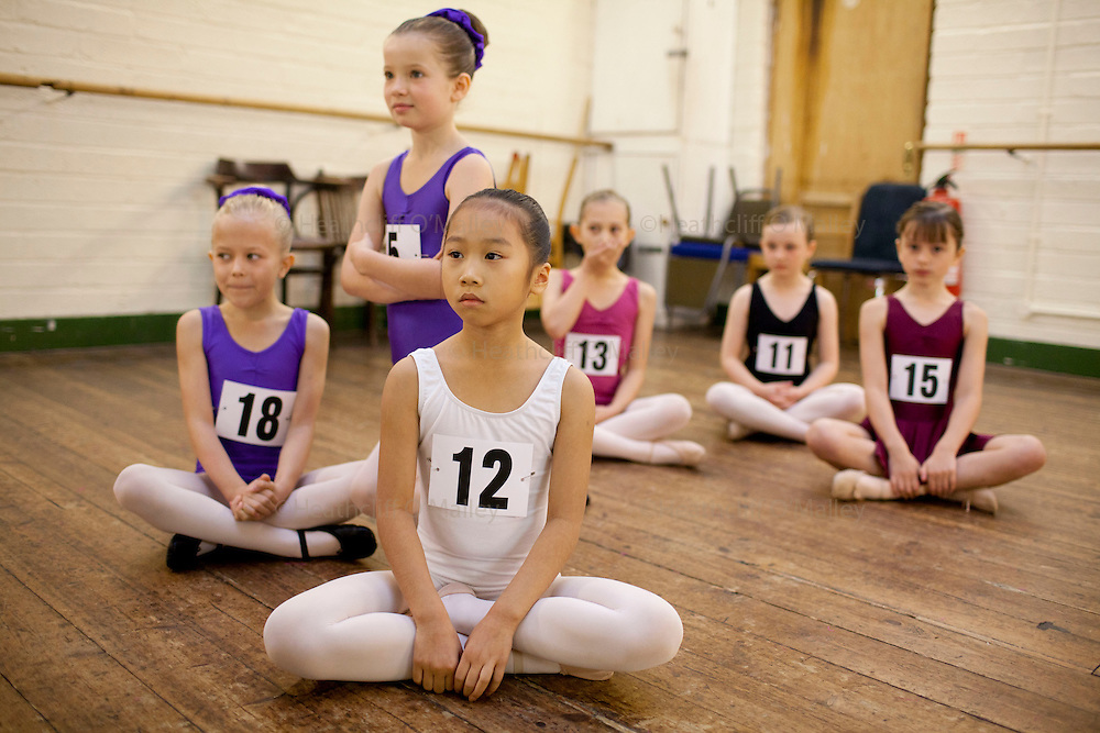 """Mcc0035274 . Daily Telegraph..The warm-up room..Audition's for the London Children's Ballet in Fulham today and a chance for a role in a production of """"The Little Princess"""" at the Peacock Theatre in April 2012..In the nine year olds age group pictured here there were 100 auditionees for a mere 7 places...London 30 October 2011."""