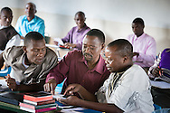 Pastoral students compare during a class taught by the Rev. Dr. Lawrence R. Rast, Jr., president of Concordia Theological Seminary in Fort Wayne, Ind., at the Evangelical Lutheran Church in Tanzania – South-East of Lake Victoria Diocese (ELCT-SELVD) Bishop Emmanuel Makala Training Center on Friday, March 13, 2015, in Shinyanga, Tanzania. LCMS Communications/Erik M. Lunsford