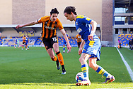 AFC Wimbledon midfielder Ethan Chislett (11) battles for possession with Hull City defender Alfie Jones (15) during the EFL Sky Bet League 1 match between AFC Wimbledon and Hull City at Plough Lane, London, United Kingdom on 27 February 2021.