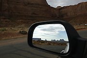 View of Monument Valley reflected in a car mirror on the southern border of Utah with northern Arizona. The valley lies within the range of the Navajo Nation Reservation. The Navajo name for the valley is Tsé Bii' Ndzisgaii - Valley of the Rocks.