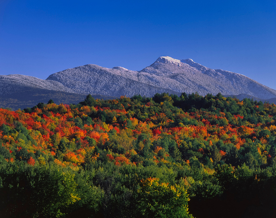Snow tops hightest peaks with fall foliage on lower hills, Mt Mansfield, Cambridge, VT