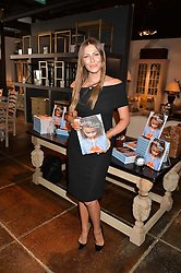 TALI SHINE at a party to celebrate the publication of 'Feeding The Future' by Lohralee Astor and Tali Shine held at OKA,155-167 Fulham Road, London on 8th June 2016.