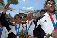 28/08/04 - ATHENS - GREECE -  - OLYMPIC FOOTBALL - FINAL MATCH - MENS  -  <br />ARGENTINA (1) Vs. PARAGUAY (0) At the Olympic Stadium in Athens. Argentine win the goal medal<br />Argentine players celebration. Here JAVIER SAVIOLA- ANDRES D'ALESSANDRO - CESAR DELGADO.<br />© Gabriel Piko / Argenpress.com / Piko-Press