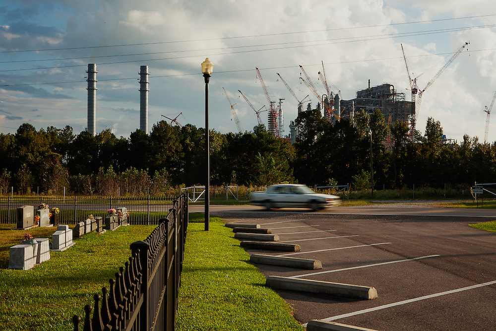 """Kemper County, MS – OCTOBER 4, 2013: <br /> The Kemper County Energy Facility rises over the tree line in rural Mississippi. The facility, which received a $270 million grant from the Department of Energy, is the first of its kind to use lignite coal in a """"combined cycle"""" approach to gasification – a method by which the combustion of synthetic gas produces electricity. Mississippi Power began construction on the facility in June 2010, but numerous delays and high cost overruns have prevented the plant from becoming commercially operational. CREDIT: Bob Miller for The Wall Street Journal<br /> <br /> CLEANCOAL"""