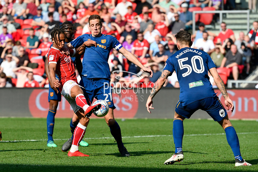 Bobby Reid (14) of Bristol City battles for possession with Michael Dawson (21) of Hull City during the EFL Sky Bet Championship match between Bristol City and Hull City at Ashton Gate, Bristol, England on 21 April 2018. Picture by Graham Hunt.