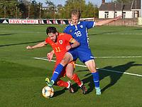 Football - 2023 UEFA U21 Championship - Qualifying - Group E - Wales vs Moldova - Steboneath Park, Llanelli<br /> <br /> Cojocari Moldova collides with Jo Adams Wales <br /> COLORSPORT/WINSTON BYNORTH