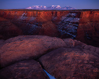 Twilight over the La Sal Mountains and reflected and sunset glow in the canyon near Canyonlands National Park, Utah, USA