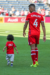 June 10, 2017 - Sat June 10th - Chicago Fire defender Johan Kappelhof (4)walks with a toddler after their victory over Atlanta United after their MSL Soccer game between The Chicago Fire and Atlanta United at Toyota Park in Bridgeview, IL. (Credit Image: © Gary E Duncan Sr via ZUMA Wire)
