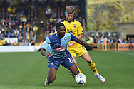 Wycombe Wanderers striker (on loan from Millwall) Fred Onyedinma (19) draws a foul from Oxford United defender (on loan from Everton) Luke Garbutt (3) during the EFL Sky Bet League 1 match between Wycombe Wanderers and Oxford United at Adams Park, High Wycombe, England on 15 September 2018.