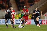 Adama Traoré of Middlesbrough goes past Leeds United midfielder Eunan O'Kane  during the EFL Sky Bet Championship match between Middlesbrough and Leeds United at the Riverside Stadium, Middlesbrough, England on 2 March 2018. Picture by Paul Thompson.